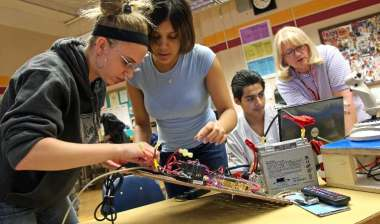 photo of students working on robot