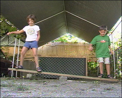 Children balancing on a seesaw