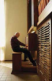 photo of Donald Knuth playing his home organ