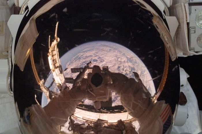 photo of astronaut's faceplate reflecting earth