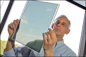 Steven Freilich leads a team working on next-generation TV and computer screens, examines a thermal color filter.