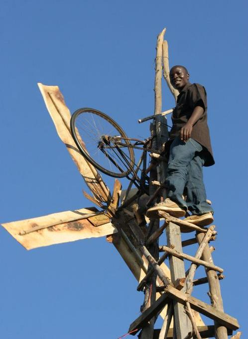 photo of William Kamkwamba on his windmill