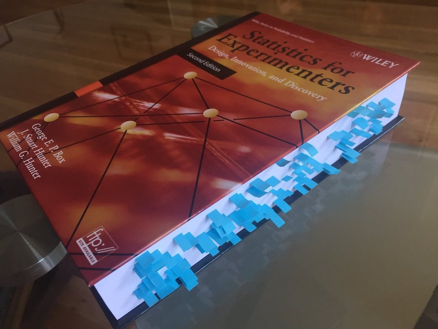 photo of Statistics for Experimenters with many blue bookmarks shown